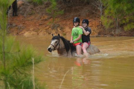 Gabrielle and Kae on Queen in the pond