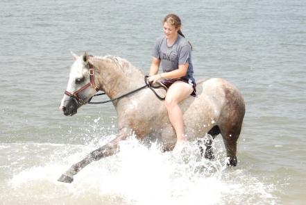Sydney swimming with Bella on Amelia Island
