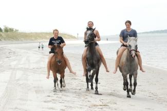 Porker and Bella with Gabrielle and Sydney on Amelia Island, FL