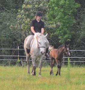 Syd riding Bella while Lee follows along